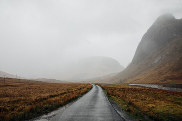 Foggy country lane in Glen Etive, Scottish Highlands