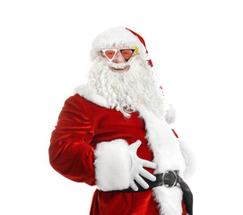 Authentic Santa Claus wearing funky sunglasses on white background
