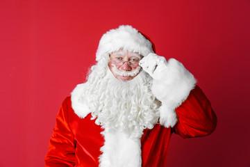 Portrait of authentic Santa Claus on color background