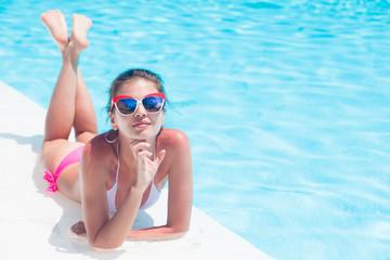 young beautiful woman in bikini relaxing in spa pool