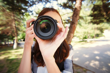 Large front camera lens in girls photographer, paparazzi, in summer in the park