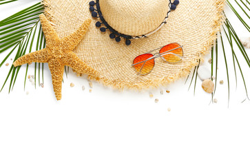 Flat lay composition with stylish hat and beach objects on white background