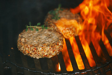 lamb burgers spiced by lamb rub on bbq grill with flame