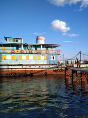 Boat ship Volga river embankment blue water sky summer nature photo