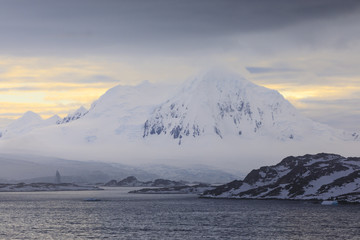 Misty Mount William at sunrise, rising from tidewater glaciers, Anvers Island, Antarctic Peninsula, Antarctica, Polar Regions