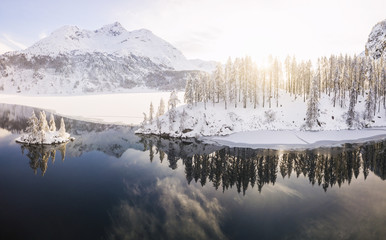 Aerial panoramic view of Lake Sils and Plaun da Lej during winter, Maloja Region, Canton of Graubunden, Engadine, Switzerland, Europe (Drone)