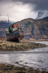 Old boat wreck at Caol with Ben Nevis in the background, Scottish Highlands, Scotland, United Kingdom, Europe