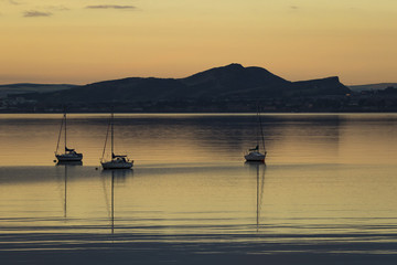 Sailboats at sunrise in Aberdour with Edinburgh in the background, Fife, Scotland, United Kingdom, Europe