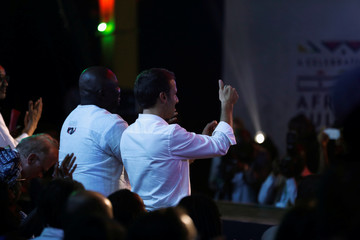 French President Emmanuel Macron gives a thumbs-up sign as Nigerian musician Femi Kuti performs during his visit to the Afrika Shrine nightclub in Nigeria's commercial capital Lagos