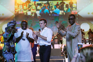 French President Emmanuel Macron stands on stage with Angelie Kidjo, Lagos state governor Akinwunmi Ambode and Senegalese singer Youssou N'Dour during Macron's visit to the Afrika Shrine nightclub in Nigeria's commercial capital Lagos