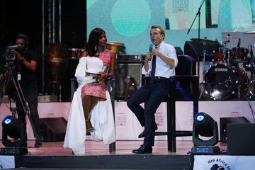 French President Emmanuel Macron speaks during an interview on stage at his visit to the Afrika Shrine nightclub in Nigeria's commercial capital Lagos