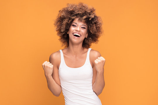 Beautiful happy african american woman celebrating victory.