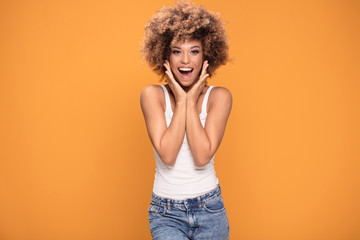 Surprised amazed beautiful afro woman with wide open smiling mouth. 壁紙(ウォールミューラル)