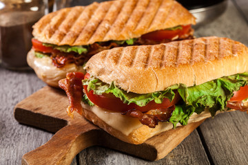 Foto op Aluminium Snack Toasted ciabatta sandwich with smoked bacon, cheese and tomato