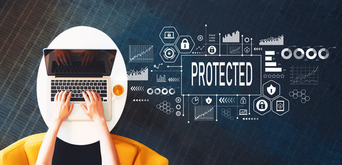Protected with person using a laptop on a white table