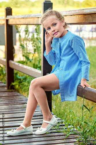 23ee5b0548d3 Little girl model wearing stylish clothes in marine style outdoors ...