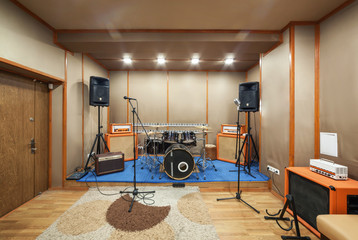 Sound studio room with drum kit.