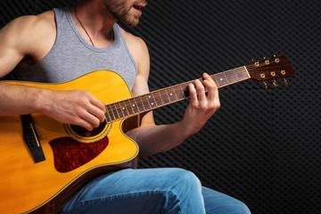 Handsome rock guitarist practicing.