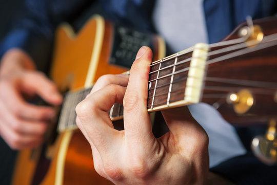 Rock guitarist practicing.