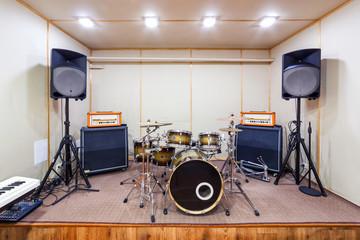 Sound studio room with drum kit.
