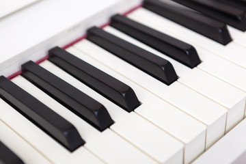 Close up of black and white piano keys.