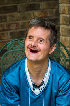 Older Man With Downs Syndrome and No Teeth Delightful Smile