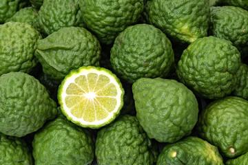 Kaffir limes, one cut citrus fruit for herbal medicine