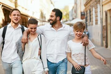 Happy People. Friends Walking On Street