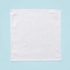 White cotton towel mock up template square size fabric wiper isolated on blue background with clipping path, flat lay top view