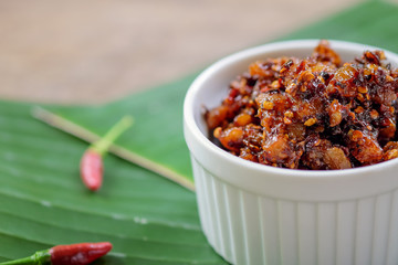 Thai chili paste on banana leaf background