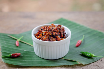 Thai chili paste on banana leaf background