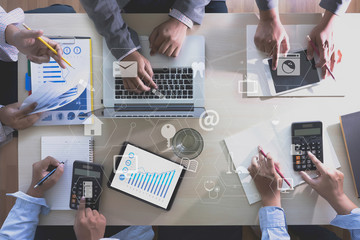 Fototapeta ONLINE ADVERTISING Business team hands at work with financial reports and a laptop obraz