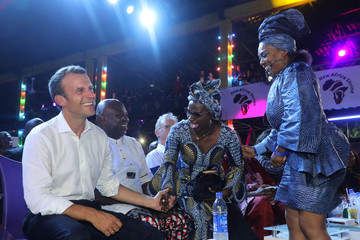 French President Emmanuel Macron laughs with Angelique Kidjo and Lagos Governor Akinwunmi Ambode at the Afrika Shrine in Lagos