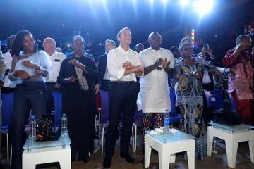French President Emmanuel Macron and Lagos Governor Akinwunmi Ambode dance at the Afrika Shrine in Lagos