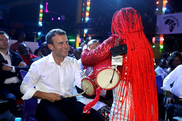 French President Emmanuel Macron performs with musicians at the Shrine Africa in Lagos