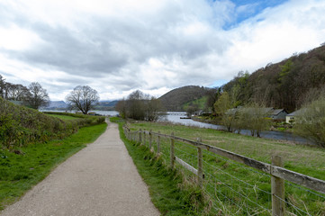 Walkway from Pooley Bridge village to the scenic lakeside of Ullswater in Lake District National Park, England, UK