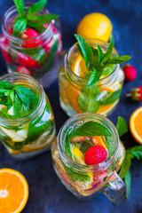 Fresh lemonade jar with mint, summer fruits and berries
