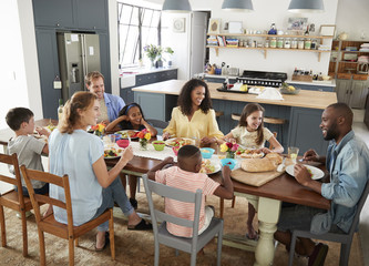 Two families having lunch together at home, elevated view