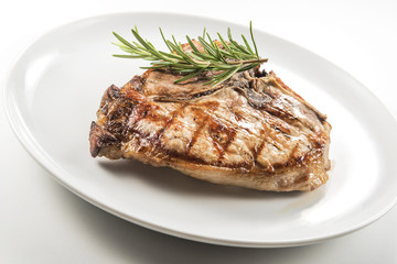 Grilled t-bone chop of pork