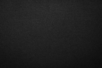 Photo sur Aluminium Tissu Black fabric texture background. Dark clothing material.