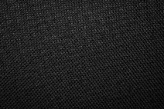 Black fabric texture background. Dark clothing material.