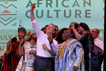 French President Emmanuel Macron takes a selfie with Nollywood artists during a live show in the AfriKa Shrine in Lagos