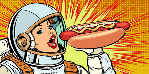 Hungry woman astronaut eating hot dog sausage