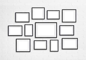 Black wooden photo frames on white bricks wall, twelve units set mock up, 3d illustration