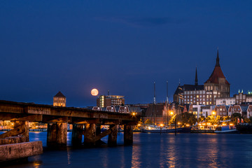 Rostock. Night Panorama view to Rostock in Germany. River Warnow and City port.
