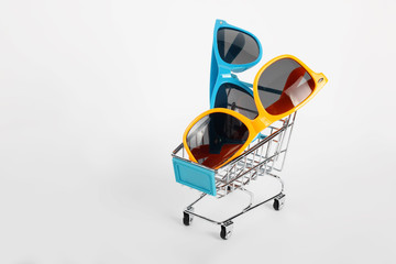 Summer shopping - Two pairs of sunglasses on the Shopping cart