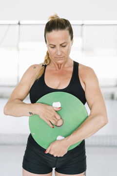 Woman exercising with disc