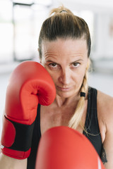 Serious female in boxing position