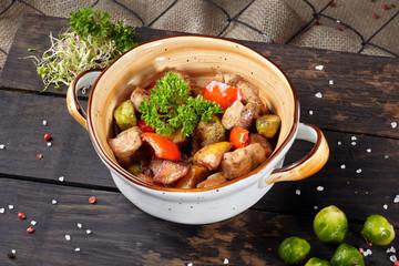 Braised pork cooked in a ceramic pot.