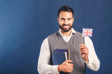Eastern bearded man holding English flag, successful language learning concept, studio isolated background